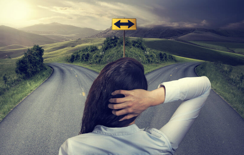 Decision making: woman at fork in road