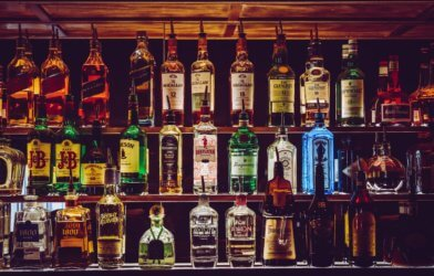 Alcohol bottles at a bar