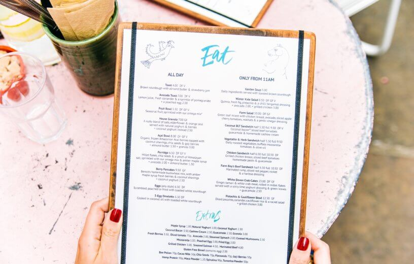 Person holding menu in restaurant