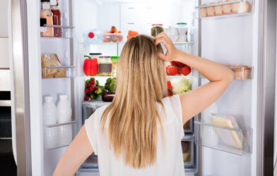Woman looking at the food in her refirigerator