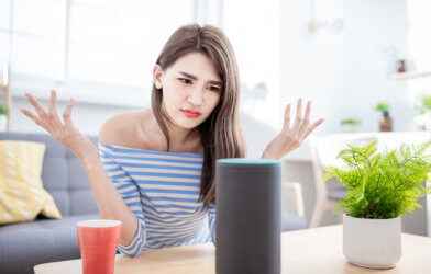 Woman using digital assistant Alexa
