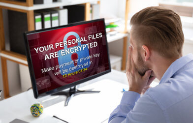 Person Looking At Computer Screen Hacked By Ransomware Hacker
