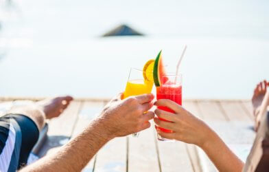 People toasting their drinks on vacation