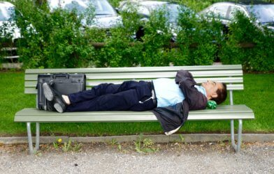 Man sleeping or taking a nap on a bench