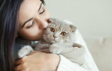 Woman kissing her cat