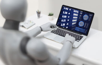 Robot financial advisor on computer