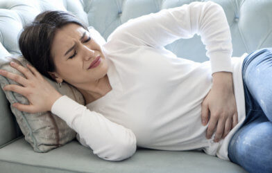 Woman experiencing stomach or menstrual pain