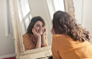 Woman staring at herself in the mirror