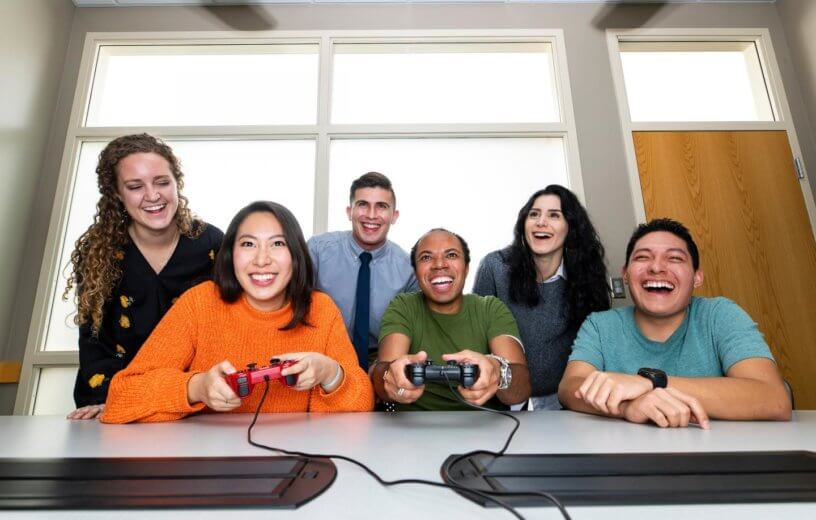 Office workers playing video game