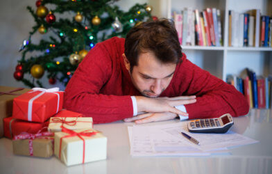 Man in debt from holiday spending, expenses