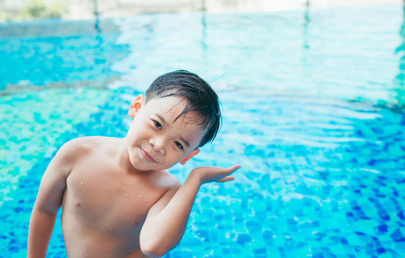 Young swimmer with water in his ear