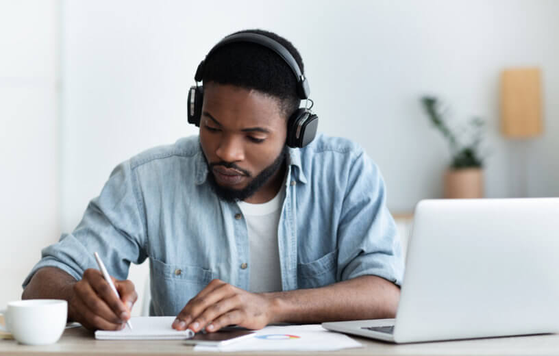 Man listening to music while working