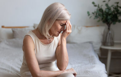 Older woman stressed, possibly from menopause