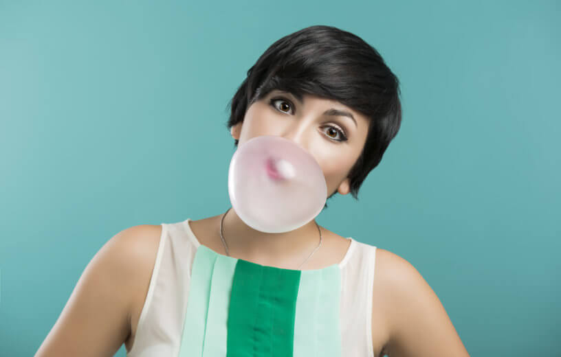 Woman blowing bubble with gum
