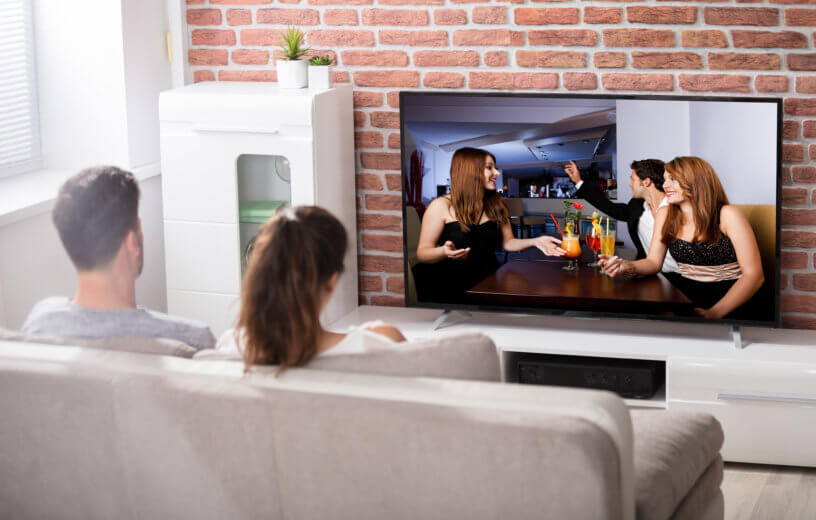 Couple watching show on TV