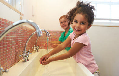 Hand hygiene: Children washing hands at school