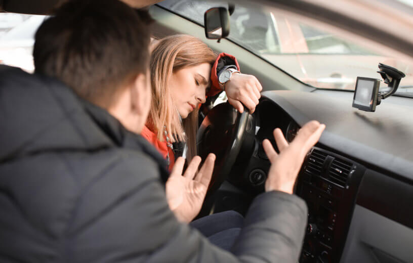 Tired couple having argument in car