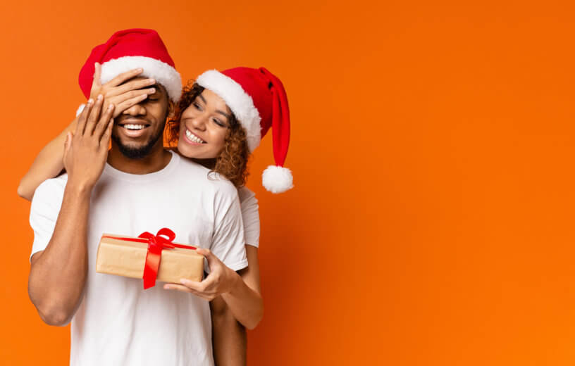 Girlfriend or wife giving partner a Christmas gift