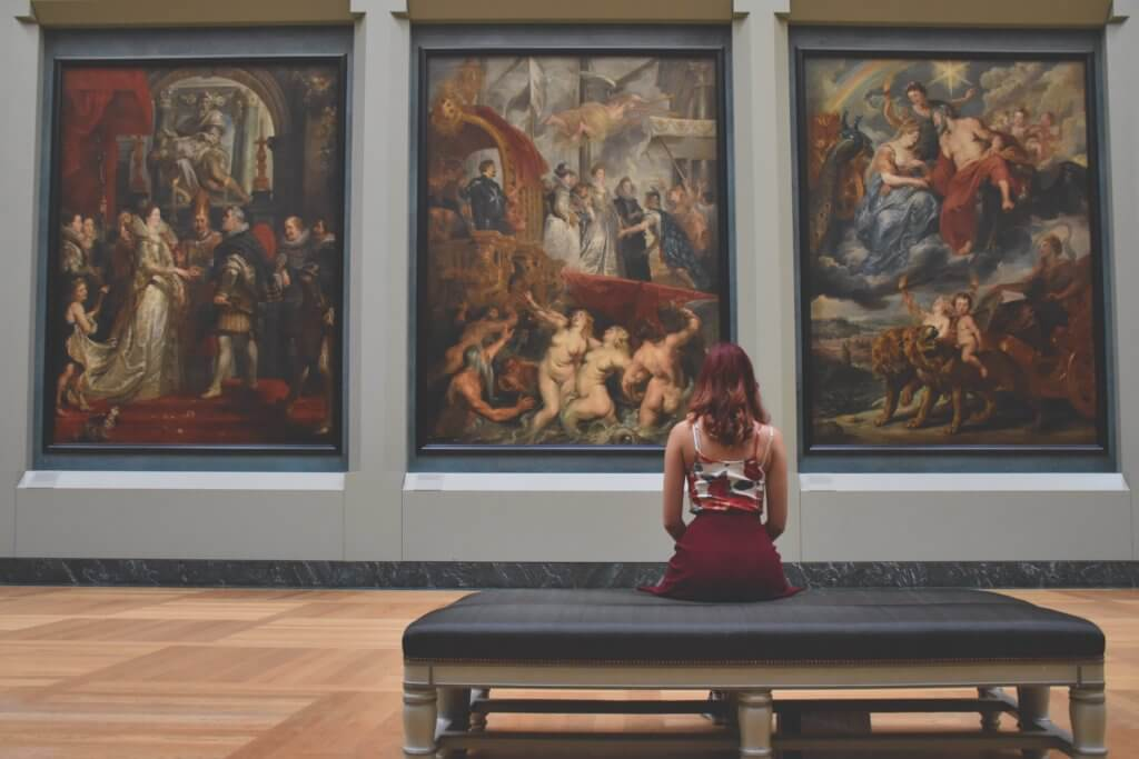 Woman sitting at art gallery or museum