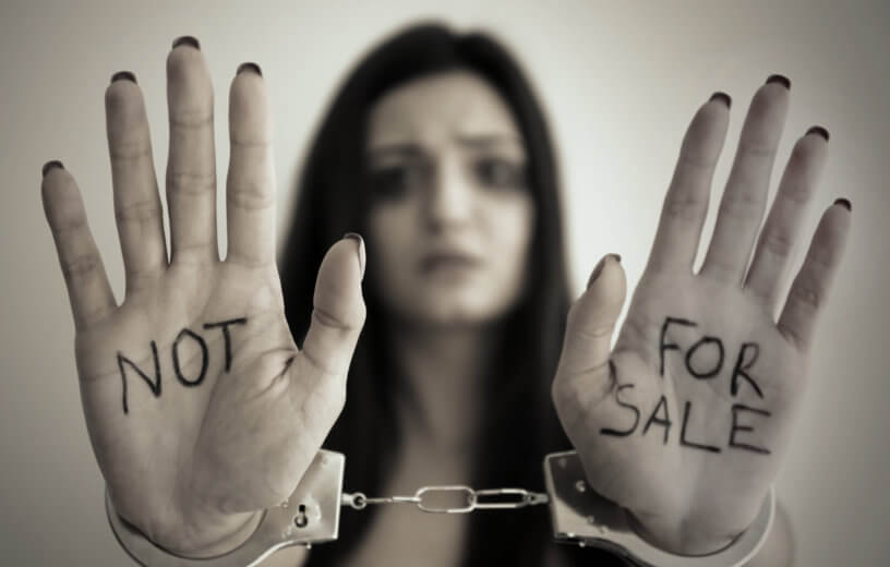 """Sex trafficking: Woman in handcuffs with hands showing, """"Not For Sale"""""""