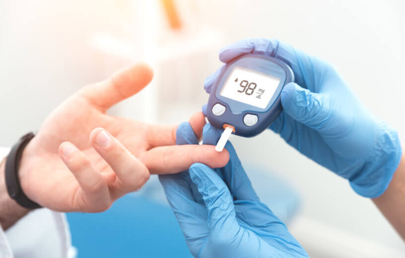 Doctor checking blood sugar level in diabetes patient