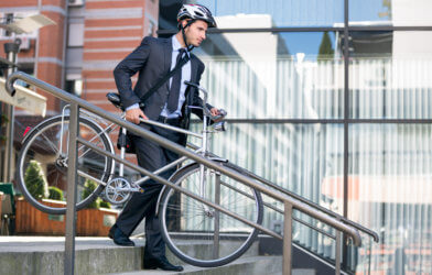 Businessman biking to work