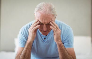 Stressed older man with gray hair
