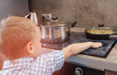 Child gets burn from hot stove