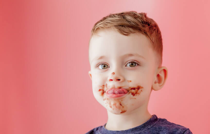 Child with chocolate on face