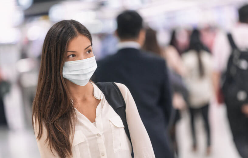 Woman wearing face mask at airport amid virus outbreak
