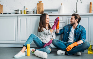Couple doing house cleaning