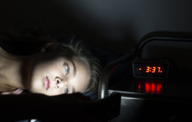 Teen or child awake in bed in middle of night