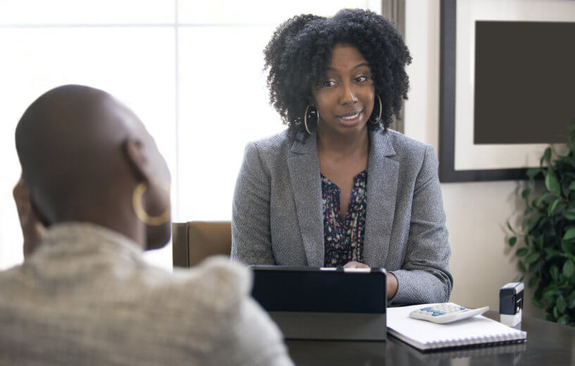 Boss talking to employee in meeting or interview