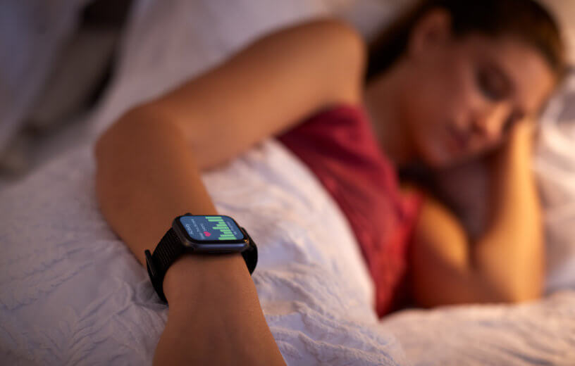 Woman sleeping with sleep tracker