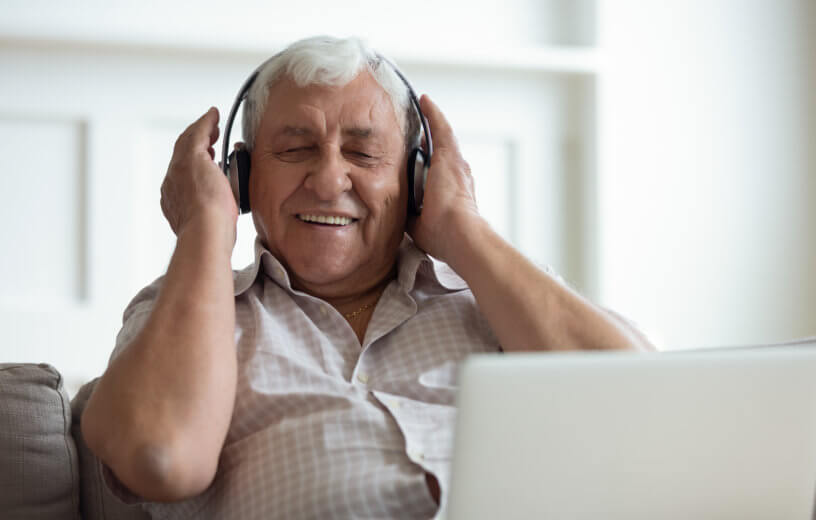 Older man listening to music