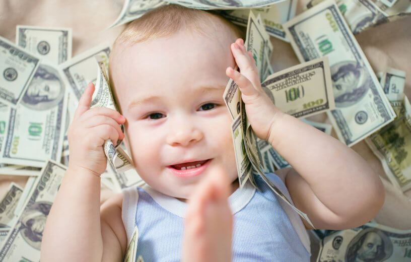 Baby laying in money