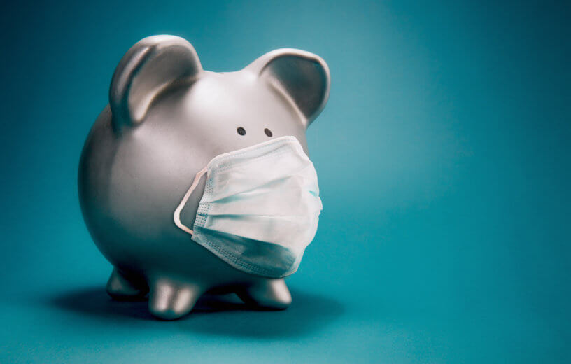 Piggy bank with face mask during coronavirus outbreak