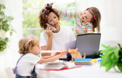 Mother doing work, stressed with children