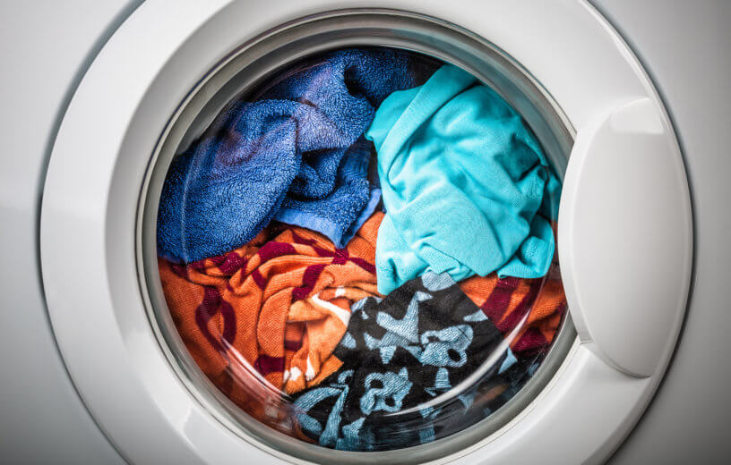 Washing machine with load of laundry inside