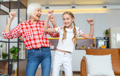 Grandmother and granddaughter dancing
