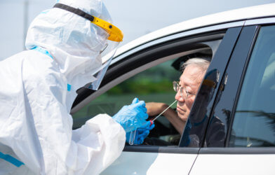 Man getting coronavirus / covid-19 test in his car