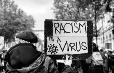 'Racism is a virus' sign at Black Lives Matter protest