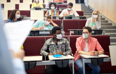 College students wearing masks during lecture for coronavirus / COVID-19 protections