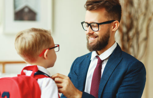Father getting young son ready for school