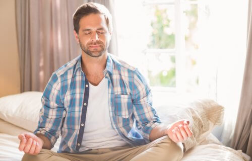 Man practicing mindfulness meditation, deep breathing