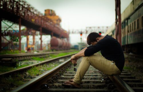 Teen or young adult upset, alone on train tracks, possibly suicidal