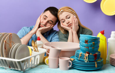 Couple laments cleaning dirty dishes