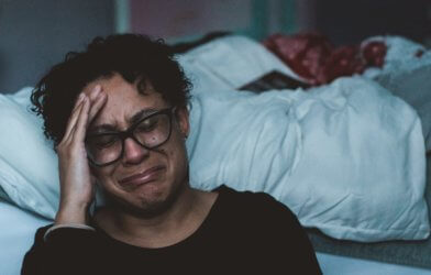 Sad woman crying, battling depression