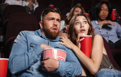 Couple watching a scary horror movie