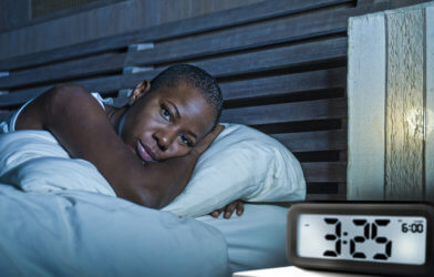 Woman suffering from insomnia, having trouble sleeping